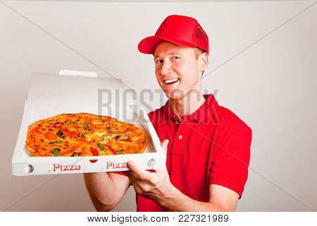 A Pizza Delivery Boy Is Showing You A Tasty Pizza