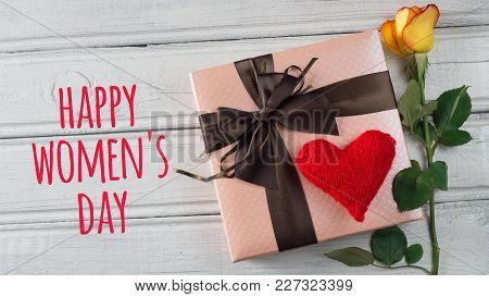 A Gift For The International Women's Day And An Inscription On A Wooden Table
