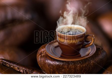 Collage Brown Cup Of Black Coffee Heating On One Coffee Bean Background