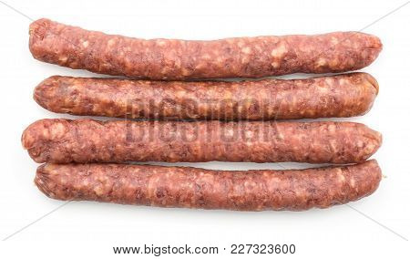 Hungarian Dry Sausages Pepperoni Top View Isolated On White Background Four Smoked In Natural Casing