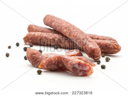 Three Hungarian Dry Sausages Pepperoni With Black Pepper And Cut Pieces Isolated On White Background
