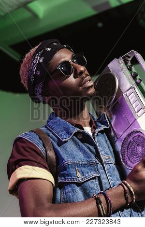 Stylish Young Handsome African American Man In Sunglasses Holding Silver Tape Recorder