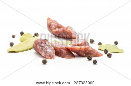 Sliced Hungarian Dry Sausages Pepperoni Pieces With Black Pepper And Bay Leaves Isolated On White Ba