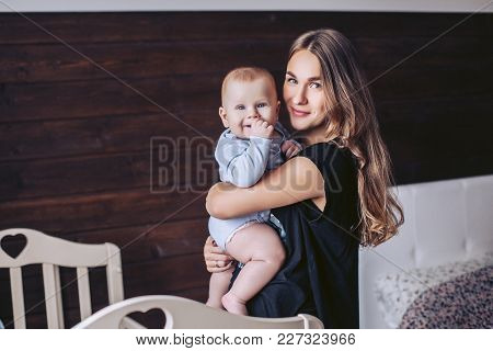 Beautiful Mother With A Little Baby Pose At Home