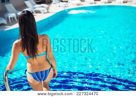 Trendy Young Woman Enjoying Sunny Day At The Hotel Resort Swimming Pool.summer Body Care,spf Protect