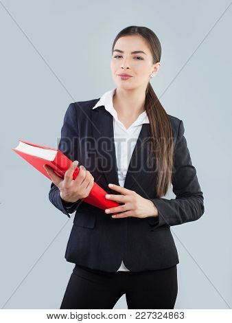 Young Businesswoman In Black Suit Holding Red Folder
