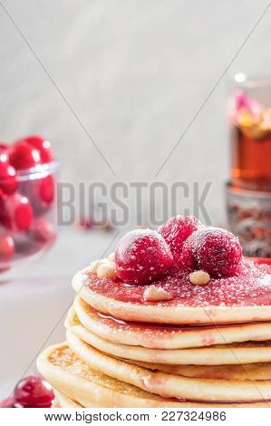 Pancakes Homemade Cake In Stack Decorated With Berries Frozen Cherry Sprinkled With Powder Sugar And