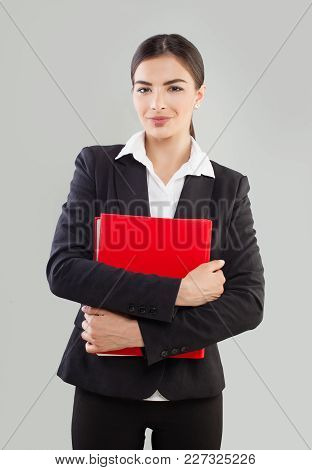 Confident Business Woman In Black Suit With Red Folder