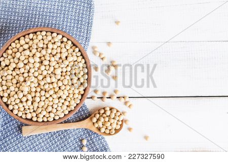 White Wood Floor With Wooden Cup With Soybean,top View And Copy Space Soybeans In Wooden Bowl With W
