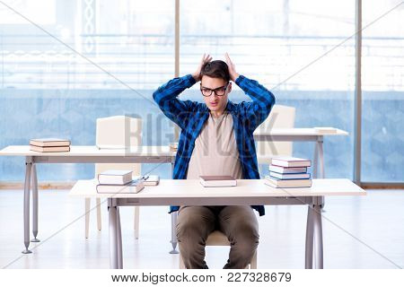 Student studying in the empty library with book preparing for exam