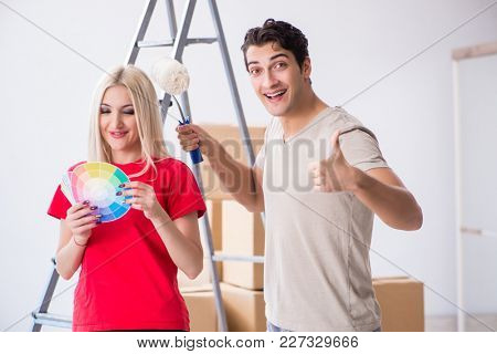 Young family doing painting job during home renovation