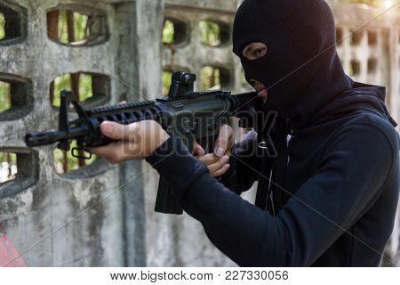 Commando With Helmet Holding M16 Gun Points Already Shoot