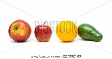 Avocado, Apples And Orange Isolated On White Background. Horizontal Photo.