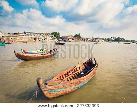 View of the river, fishing boats on the foreground. Sittwe, Myanmar
