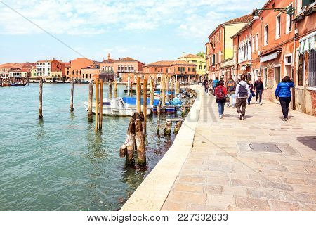 Daylight View To Parked Boats And People Walking On Sidewalk Of Grand Canal