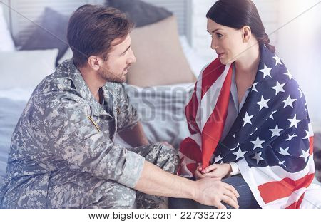 Everything Will Be Alright. Careful Wife Covered In The Usa Flag Looking At Her Husband With Eyes Fu