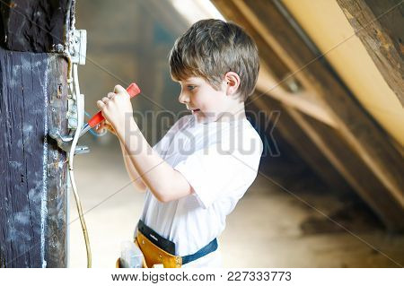 Happy Little Kid Boy Helping With Toy Tools On Construction Site. Funny Child Of 7 Years Having Fun