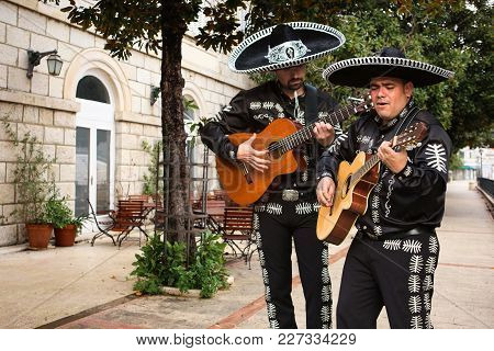 Mexican Musicians Mariachi On A City Street
