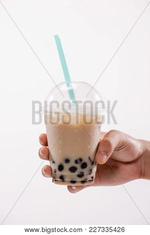 Bubble Milk Tea - Hand Holding A Plastic Glass Of Taiwan Iced Milk Tea With Boba