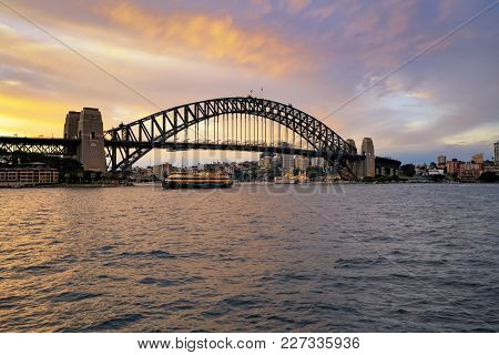 Sydney, Australia - Circa September 2016: Glorious Golden Hour Sunset View Of The Harbour Bridge In