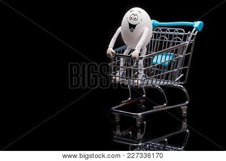 Funny Crazy Happy Egg Standing On A Cart From A Supermarket. Space For Text.