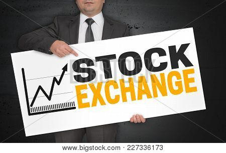 Stock Exchange Poster Is Held By Businessman.