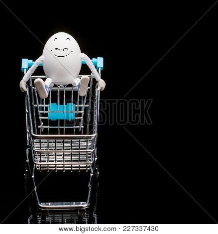 Funny Happy Smiling Egg Sitting On A Cart From A Supermarket. Space For Text.