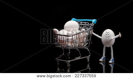 Funny Happy Smiling Egg Standing Near The Cart From A Supermarket Full Of Eggs. Space For Text. Prep