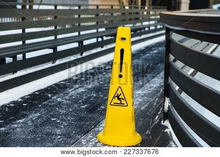 Be Aware Of Slippery Road. Slippery Yellow Surface Sign. Wet Floor Sign. Icing Concept. Selective Fo