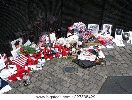 Mementos, Flowers, Photos, Decorations, Items Left At The Vietnam War Memorial In Washington, D.c. M