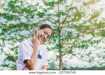 Student Girl Smiling With Nature Countryside Nature In Evening Light