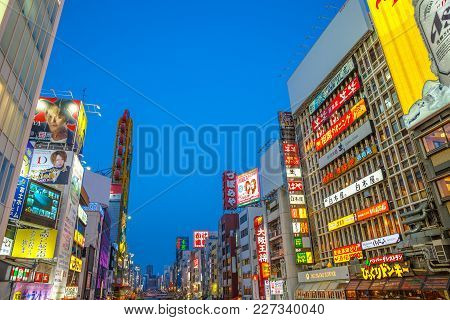 Osaka, Japan - April 29, 2017: Modern Buildings Covered With Neon Signs Along Dotonbori Canal In Nam
