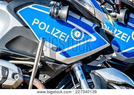 Close-up Of German Police Motor Bike In The Sun