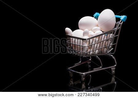 The Cart From A Supermarket Full Of Eggs. Space For Text. Preparation For Easter.