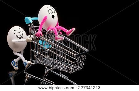 Two Funny Eggs Ride A Cart From A Supermarket.