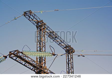High Voltage Towers With Blue Sky Background.