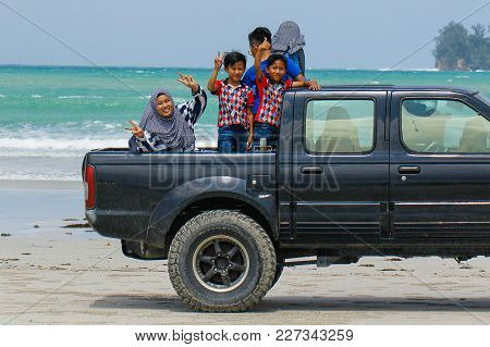 Kudat,sabah-feb 3,2018:happy Kids Having Fun On The Off-road Truck In Sandy Tropical Beach At Kudat,