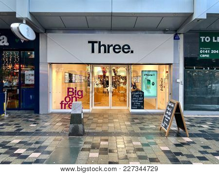 GLASGOW - FEBRUARY 19, 2018: Three mobile phone telecommunications retail shop, and brand of Hutchinson 3G, on Sauchiehall Street in Glasgow, Scotland, UK.