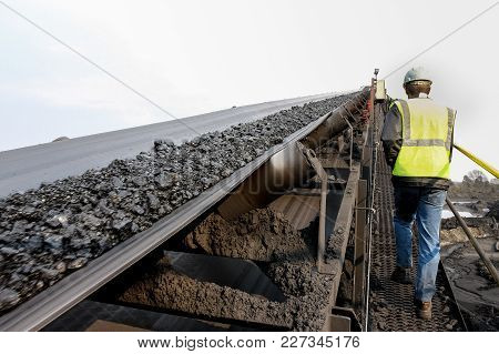 Coal Moving Along A Conveyor Belt To Be Processed