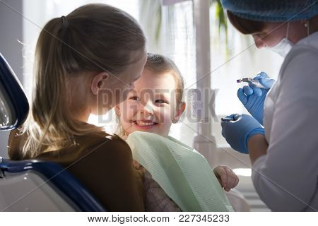 Little Child With Mommy In Stomatology Chair - Girl Is Smiling, Close Up