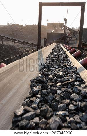 Small Pieces Of Coal Moving Along A Conveyor Belt
