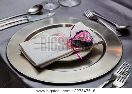 Heart Shaped Chocolate On A Silver Table Setting