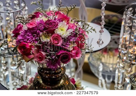 Pink And Purple Flowers On A Table Setting At Gala Dinner Or Event