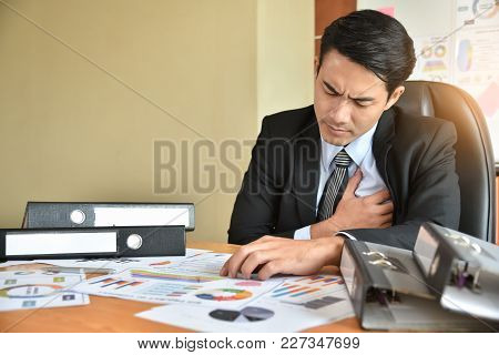 Young Asian Businessman Having Heart Attack While He Work Overtime. Chest Pain.