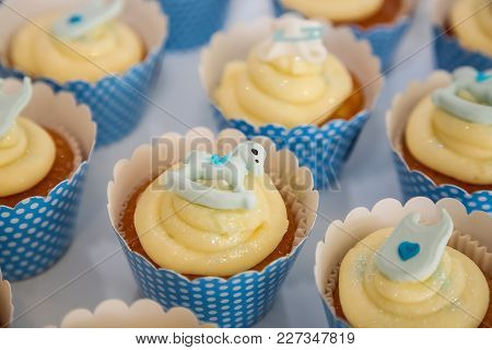 Soft Yellow Cup Cakes With A Baby Theme