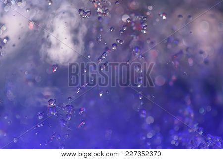 Multicolored Spray Fountain At Night In The Club