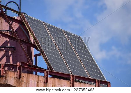 Solar Panels At The Top Of The Lighthouse. Transformation Of Solar Energy
