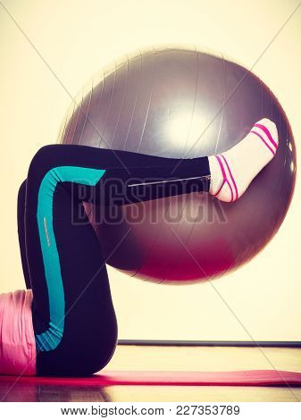 Sport, Gym, Fitness Concept. Lady Lying With Fit Ball. Girl Is Wearing Leggins, Socks. Sporty Outfit