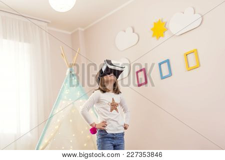 Little Girl Wearing Virtual Reality Headset, Playing In A Playoom And Having Fun