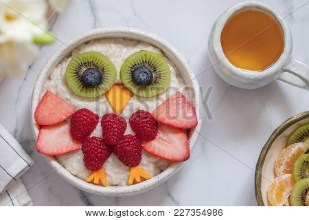 Kids Breakfast Oatmeal Porridge With Fruits And Nuts